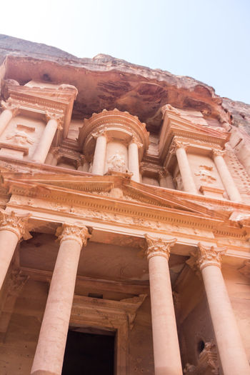 View of Treasury ruin in Petra Jordan Petra Petra, Jordan Petra Jordan Al-khazneh Built Structure Architecture Low Angle View Building Exterior The Past History Ancient Sky Travel Destinations Day Architectural Column Tourism No People Old Travel City Building Religion Clear Sky Nature Outdoors Ancient Civilization Place Of Worship Archaeology Carving