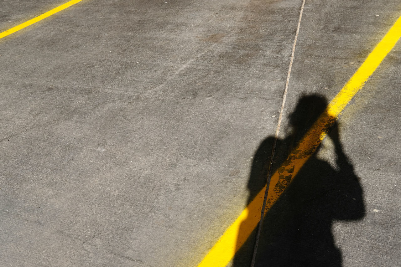 yellow, high angle view, shadow, transportation, asphalt, day, road, no people, outdoors, court