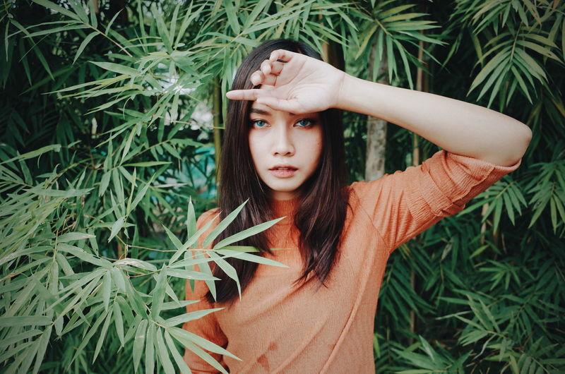 Natural beautiful Young Women Beauty Portrait Beautiful Woman Leaf Women Standing Green Color Blooming