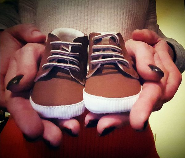 Pregnancy Announcement Baby Shoes Hands Pregnant Indoors  Cute Healthy Lifestyle Human Body Part Men Woman Baby Fashion Stories Parents To Be
