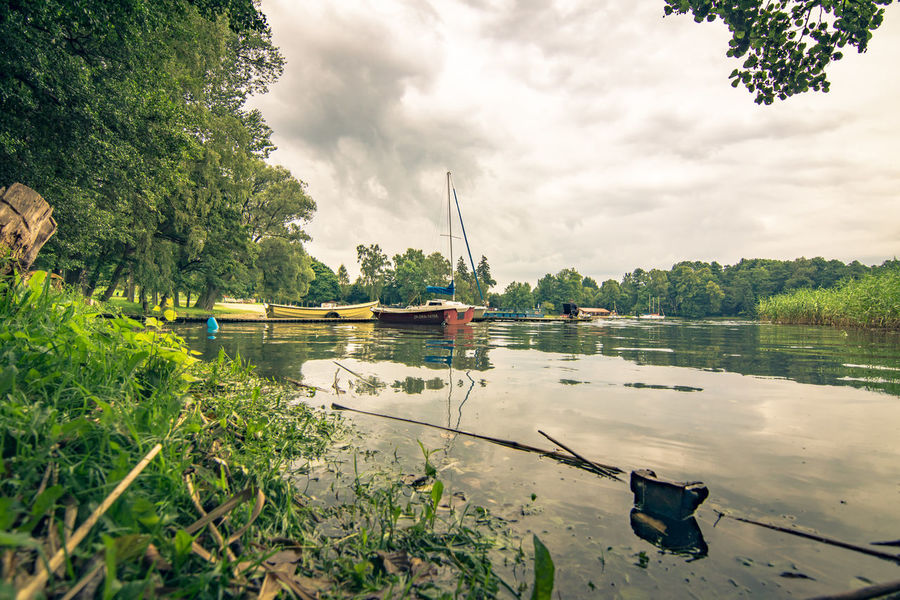 Beauty In Nature Cloud - Sky Day Green Color Mode Of Transport Moored Nature Nautical Vessel No People Outdoors Reflection River Scenics Sky Transportation Tree Water