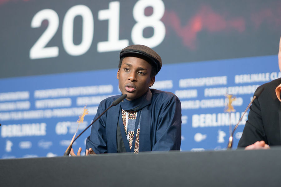 Berlin, Germany - February 24, 2018: Samuel Ishimwe, winner of the Silver Bear Jury Prize (Short Film) for the movie 'Imfura', poses at the Award Winners press conference during the 68th Berlinale AWARD Artist Berlin Event Film Festival Press Rwanda The Media Winning Arts Culture And Entertainment Berlinale Berlinale 2018 Berlinale2018 Berlinale68 Entertainment Entertainment Event Film Industry Filmmaker Imfura Mass Media One Person People Press Conference Samuel Ishimwe Young Adult