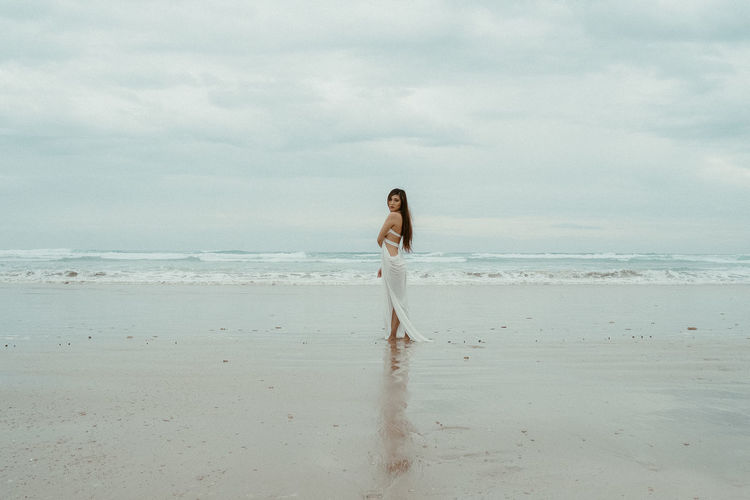 Beach Beauty In Nature Cloud - Sky Day Full Length Girl Girls Horizon Over Water Nature One Person Outdoors People Portrait Portrait Of A Woman Real People Sand Scenics Sea Sky Standing The Portraitist - 2017 EyeEm Awards Water Women Young Adult Young Women