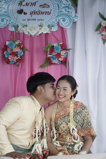 Young couple kissing in traditional clothing