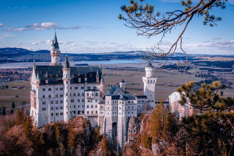 Neuschwanstein castle against cloudy sky