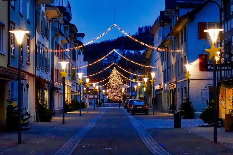 Christmas illumination in Rheineck in Switzerland. Cars Christmas Illumination City Center Rheineck St. Gallen Architecture Building Exterior Buildings Built Structure Hill Illuminated Main Street No People Outdoors Sky Street Light Switzerland The Way Forward