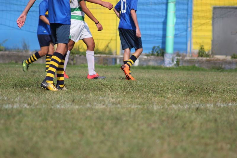 Soccer Soccer Grass Child Low Section Real People Team Sport Soccer Field Group Of People Sport Soccer Player Childhood Lifestyles Playing Men Human Leg Field Togetherness Leisure Activity People Boys