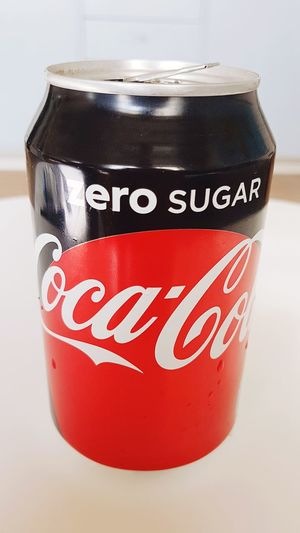 Enjoying a Coke. Drink Close-up Cocacolazero CocaCola Is My Addiction Indoors  Day No People Red Text Danger