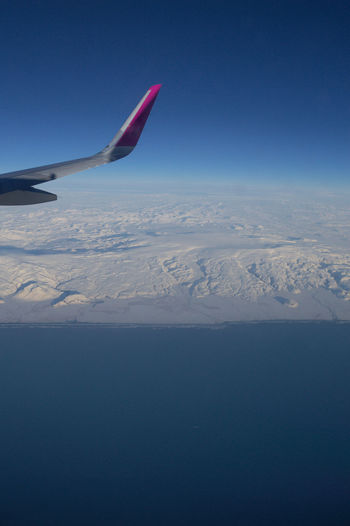 Iceland Europe Ice Snow In Flight Air Vehicle Airplane Flying Sky Aircraft Wing Scenics - Nature Transportation Mode Of Transportation No People Travel Beauty In Nature Nature Aerial View Blue Day Tranquil Scene Clear Sky on the move Mid-air Snowcapped Mountain