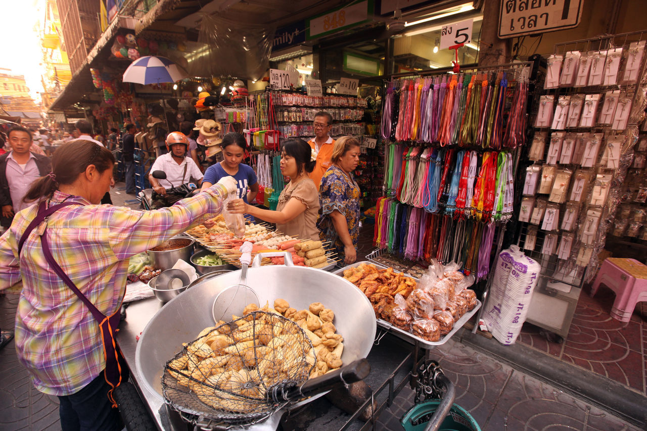 retail, market stall, market, buying, food and drink, real people, men, for sale, food, customer, small business, women, choice, variation, indoors, large group of people, lifestyles, freshness, day, adult, people