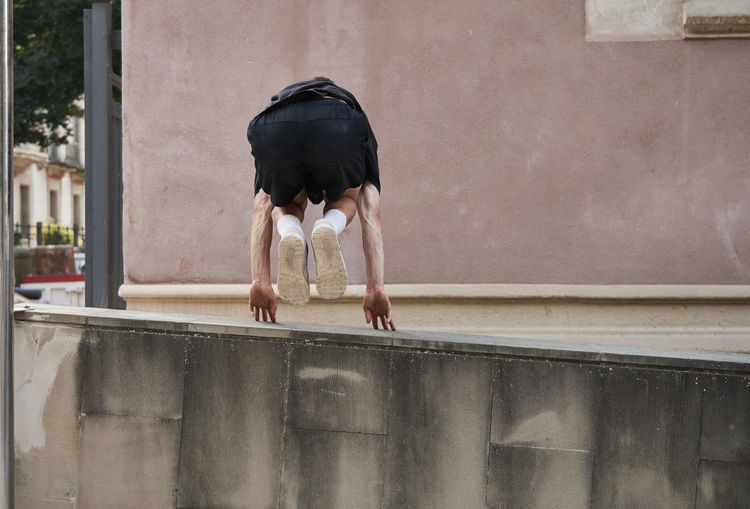 Full length of woman dancing on wall