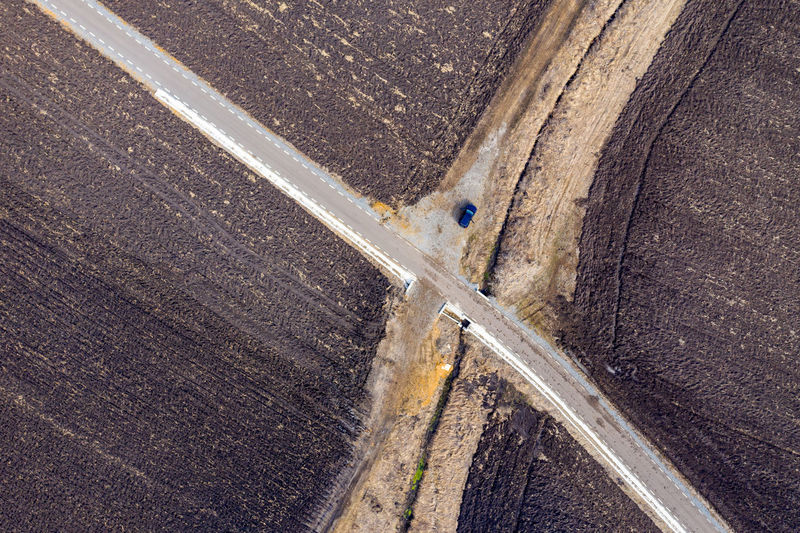 Aerial view of countryside road intersection from a drone No People Road Transportation High Angle View Day Outdoors Nature Aerial View Environment Landscape Highway Curvy Road Asphalt Drone  Dronephotography Drone Photography Droneshot Aerial Aerial Photography Aerial Shot Aerial Landscape Travel Journey Road Roadtrip