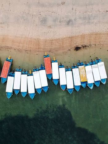All lined up and ready to go. Travel Destinations Leisure Activity Birds Eye View Bali Tanjung Benoa Beach Arrangement Orderly Man Made Object Power In Nature Dji Spark Bali Drone Photography Boats On Beach Boats And Sea Boats On Water Boats And Water Bright Colors Different Colors Lined Up In A Row Lined Up Ready To Go Boats Nautical Vessel In A Row Drying Hanging Clothesline No People Day Outdoors EyeEm Ready   EyeEmNewHere
