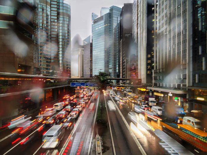 Traffic City Life Urban Hong Kong Photography In Motion IPhoneography Urban Lifestyle Cars Slow Shutter Rainy Day Weather Street Life Downtown Urban Life Wet Window Need For Speed Feel The Journey Embrace Urban Life Mobility In Mega Cities Humanity Meets Technology