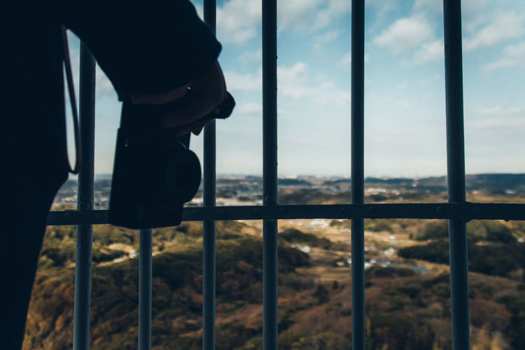 Japan Travel Destinations Travel Japan Travel Exceptional Normalcy Enjoying Life People Photographer Photography Taking Photos Shooting Photos Landscape Abstract Still Life Camera Holding Light And Shadow One Person Window Sky Cloud - Sky Nature Transparent Outdoors Day Human Body Part Metal Boundary Real People Focus On Foreground Body Part Fence Glass - Material Barrier Railing Lifestyles My Best Photo
