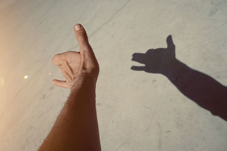 hand shadow silhouette in the street, man hand in the shadows Hand Finger Wrist Arm Shadow Silhouette Body Part Skin Nature Outdoors Sunlight Colors Colorful Gesture Concept Symbol Streetphotography Minimalism Minimal Background