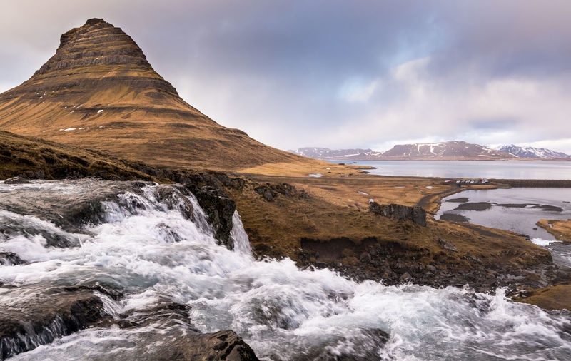 The kirkjufell mountain and the kirkjufellfoss waterfall at snaefellsnes peninsula in iceland