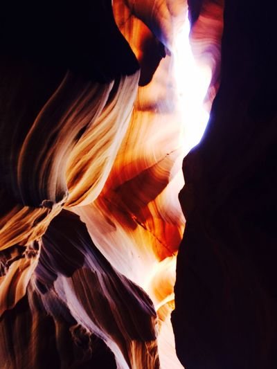 Sunlight falling on rock formation at antelope canyon