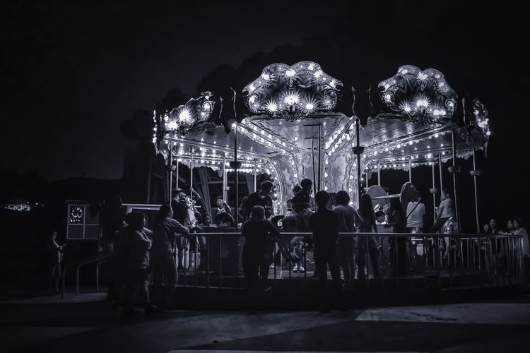 Dreaming Moments Of Life The Week Of Eyeem Dreaming Space Heaven Way Somewhere Light Light And Shadow Somewhere I Remember Playground Colorful Nightlife Night Lights Black And White Blackandwhite Photography Lighting Equipment Nice Day People Watching People Moments Black And White Black Background Happy Carousel Illuminated Amusement Park Ride Arts Culture And Entertainment Amusement Park Dark Focus On The Story