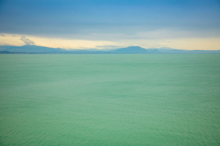 Italy Scenics - Nature Tranquil Scene Tranquility Sky Beauty In Nature Mountain Nature No People Environment Cloud - Sky Water Landscape Remote Idyllic Sea Day Horizon Outdoors Green Color Purity Turquoise Colored