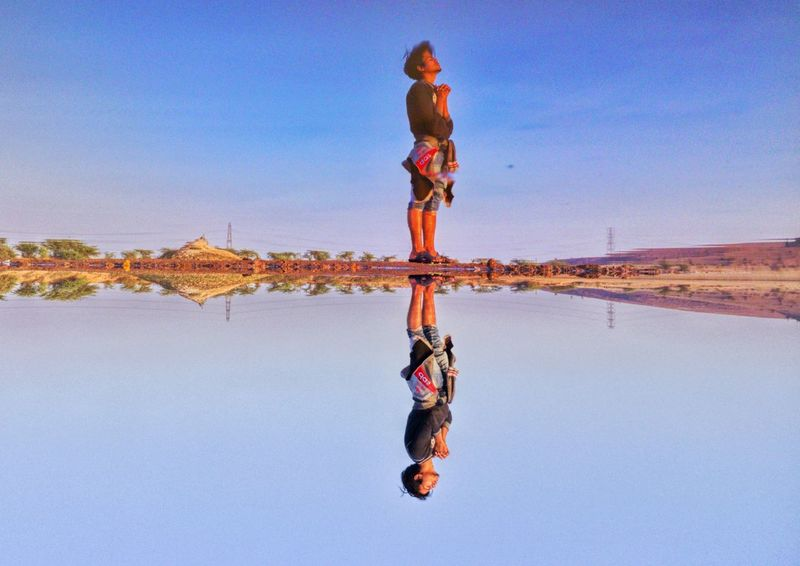 Man Pray Praying Water Reflections Upside Down EyeEm Selects Man Nature Request EyeEm Best Shots EyeEmNewHere EyeEm Gallery EyeEmBestPics EyeEm Full Length Adult Adults Only Sky Blue People Clear Sky Men