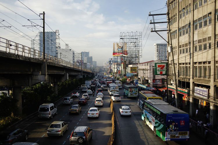 Manila Transportation Mode Of Transportation Motor Vehicle City Car Architecture Land Vehicle Built Structure Building Exterior Street Road Sky Traffic Bridge Day Bridge - Man Made Structure City Street No People Nature Building Outdoors Office Building Exterior Busy Philippines