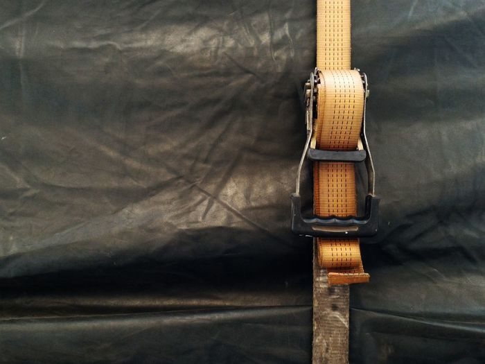 High angle view of belt on plastic
