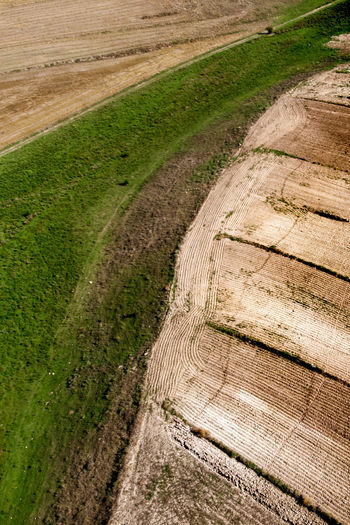 An aerial view of the fields. Landscape Environment Land Tranquil Scene Tranquility Scenics - Nature Nature No People Day Plant Outdoors Field Dirt Rural Scene Agriculture Growth Farm Grass High Angle View Footpath Top View Dronephotography Aerial View Fieldscape Geometric