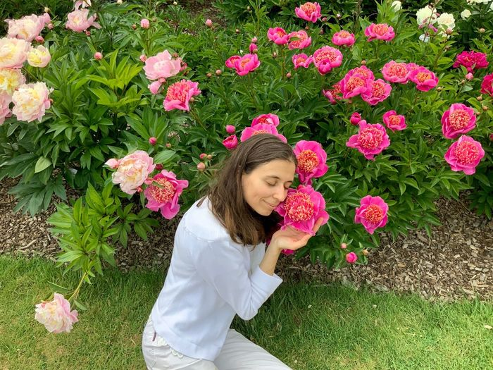 Plant One Person Flower Flowering Plant Real People Leisure Activity Lifestyles Women Nature Day Growth Casual Clothing Young Adult Young Women Freshness Fragility Pink Color Outdoors High Angle View
