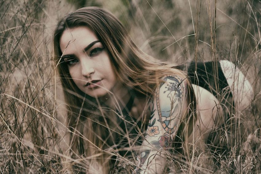 Old habits die hard. Beauty Young Adult Grass Beautiful Woman Beautiful People Outdoors Rural Scene Portrait Nature Timothy Grass Adult Long Hair Women Headshot Day Dreaming Summer One Person Only Women Blank Expression
