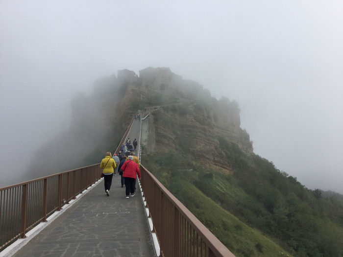 Walking on the bridge toward the clouds