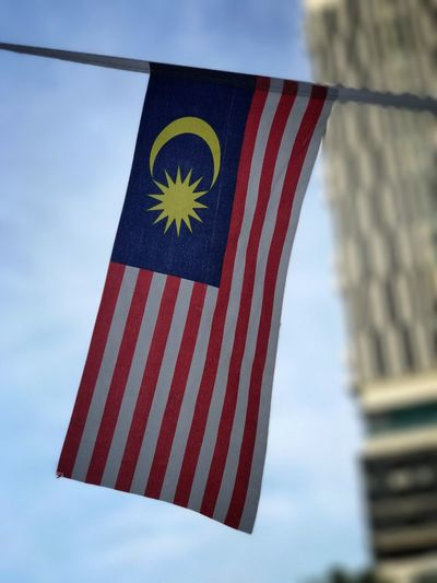 Happy Malaysia Day Patriotism Striped Flag Stars And Stripes Low Angle View Sky Freedom Day Pride Flag Pole No People National Icon Blue Outdoors Close-up Red Cloud - Sky