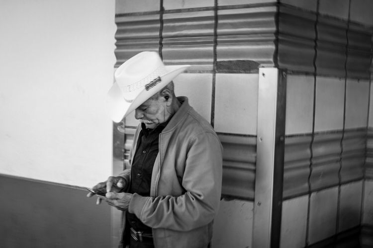 Black And White Blackandwhite Documentary Fujifilm Streetphotography Fujifilm_xseries Fujix100f Photo444 One Person Real People Architecture Men Clothing Hat Built Structure