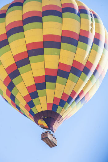 Multi Colored Hot Air Balloon Balloon Air Vehicle Transportation Flying Low Angle View Adventure No People Day Pattern Clear Sky Mid-air Nature Sky Striped Outdoors Sport Parachute Blue Ballooning Festival