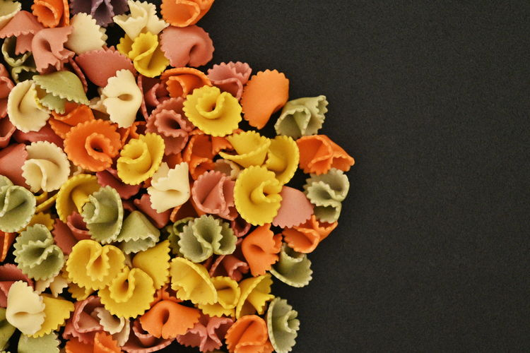 High angle view of chopped vegetables against black background