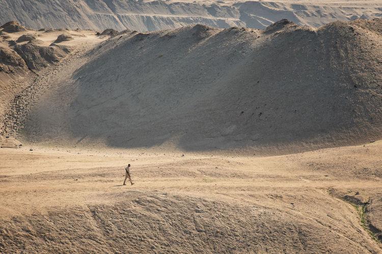 Full length of man on arid landscape