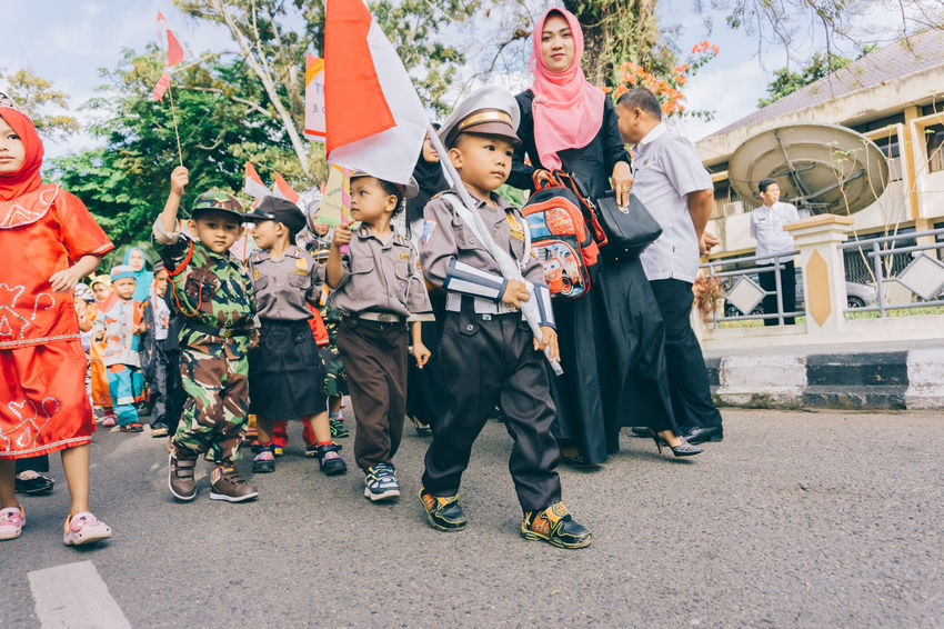kindergarten carnival Adult Boys Carnival Carnival Crowds And Details Celebration Child Crowd Cultures Day EyeEmNewHere Flag Kids Kindergarten Large Group Of People Men Outdoors People Police Soldier Street Street Photography Traditional Costume Women The Street Photographer - 2017 EyeEm Awards The Photojournalist - 2017 EyeEm Awards