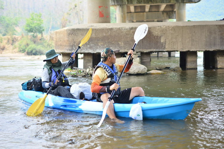 Water Outdoors Chiang Rai, Thailand Oar Nautical Vessel Lifestyles Leisure Activity Men Day Real People Two People Holding Transportation Adult Sitting Togetherness Kayak People Sport Nature Women