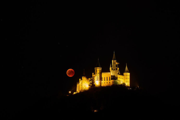 Hohenzollern Castle with Blood Moon Full Moon Hohenzollern Castle Architecture Blood Moon Building Building Exterior Dark History Illuminated Night No People Outdoors Sky Tourism Travel Travel Destinations