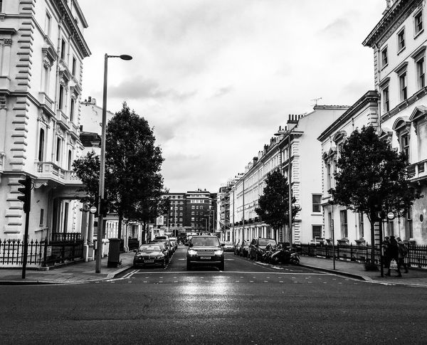Streetphotography Range Rover London Building Exterior Built Structure City Architecture Street Transportation Sky Road Street Light Outdoors Tree Day No People Adapted To The City Adapted To The City