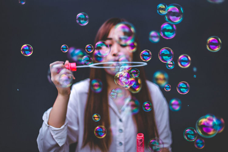 Bubble stick. Funny Hello World Front View Leisure Activity Lifestyles One Person Young Adult Bubble Bubble Wand Soap Sud Mid-air Blowing Standing Adult Multi Colored Vulnerability  Fragility Holding Women Transparent Portrait Fun Vulnerability  Bubble Wand Standing Adult Fun