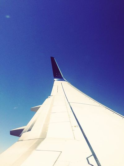 Airplane Airplane Wing Clear Sky No People Blue Day Sunlight Low Angle View Outdoors Sky