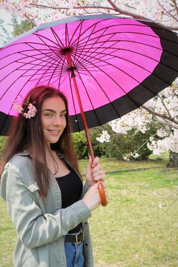 Pink Parasol Spring Springtime Spring Flowers Brunette Young Women Young Adult Beautiful Beautiful Woman Pink Color Parasol Umbrella Protection Holding Human Body Part Human Hand Three Quarter Length Looking At Camera Cherry Blossom Cherry Blossoms Flowers In Hair Long Hair Smiling Happiness My Best Photo