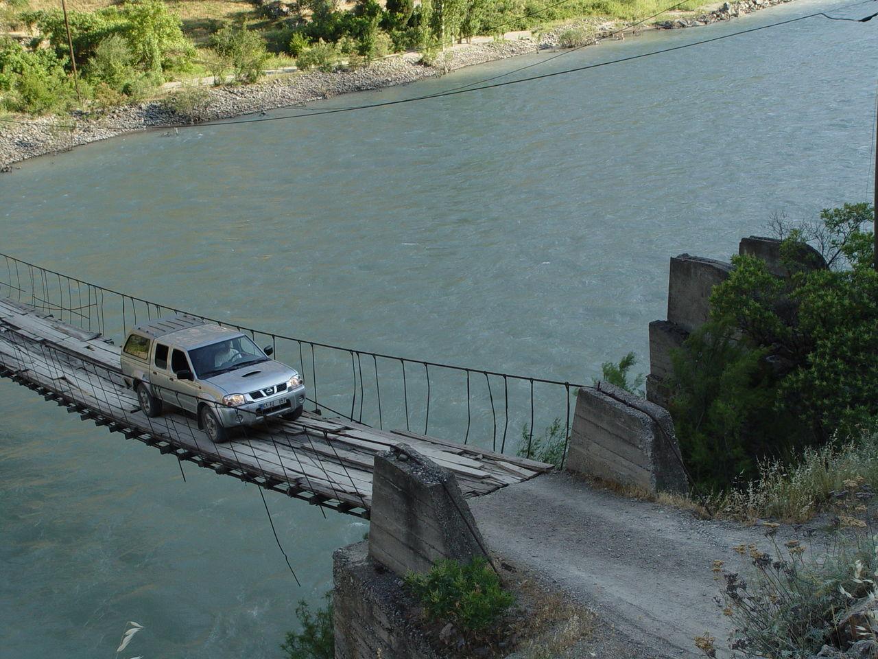 HIGH ANGLE VIEW OF BRIDGE ON RIVER