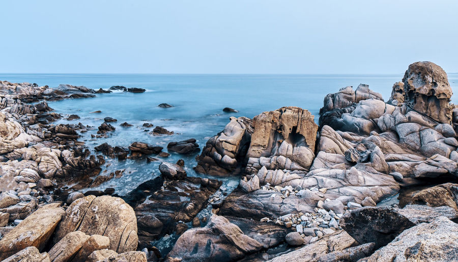 Rock Rock - Object Water Sea Solid Sky Horizon Over Water Scenics - Nature Beauty In Nature Horizon Beach Nature Land Clear Sky Tranquility Tranquil Scene No People Day Rock Formation Rocky Coastline Eroded