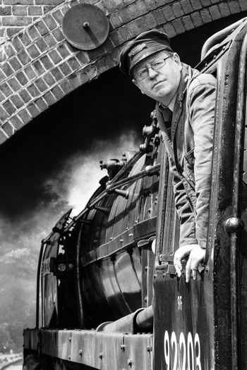 Volunteer train driver waiting for a signal at Weybourne Station, Norfolk, UK Man At Work Man At Work On The Railway Track North Norfolk Railway Steam Vintage Style Black And White Black And White Collection  Black And White Photography Black And White Portrait Eyem Best Shots Eyem Gallery Mode Of Transportation One Person Portrait Real People Steam Locomotive Steam Locomotives Steam Train Tblack And White Train Train - Vehicle Train Driver Volunteer Work Waiting For A Signal Working Clothes