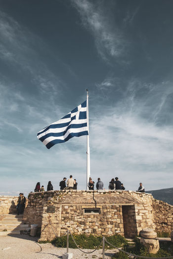 Acropolis Athens Greece Acropolis Sky Cloud - Sky Flag Patriotism History Architecture The Past Nature Group Of People Men Day Built Structure Real People People Lifestyles Women Leisure Activity Outdoors Wind Ancient Civilization