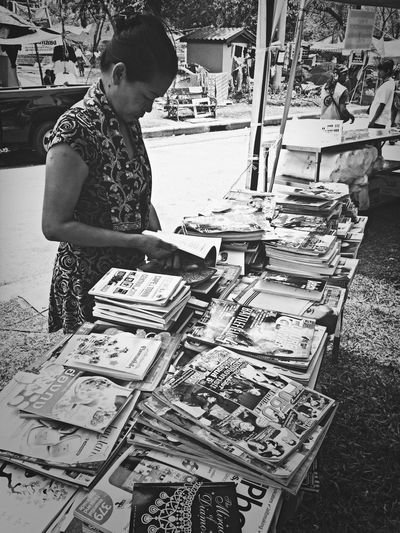 Inside the protest, there are books for free for reading Lumpini Park Family Outing