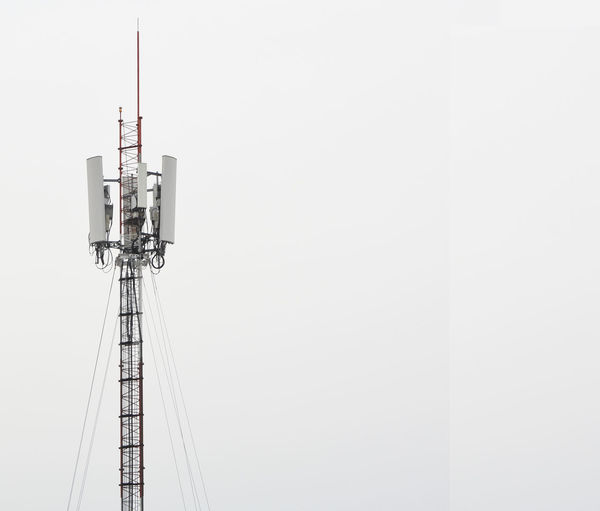 Communications tower against clear sky