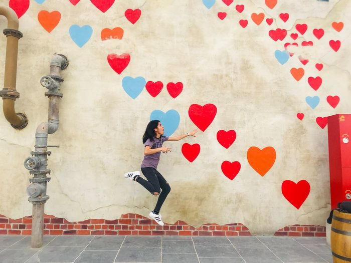 flying hearts One Person Full Length Wall - Building Feature Women Lifestyles Real People Adventures In The City Young Women Pattern